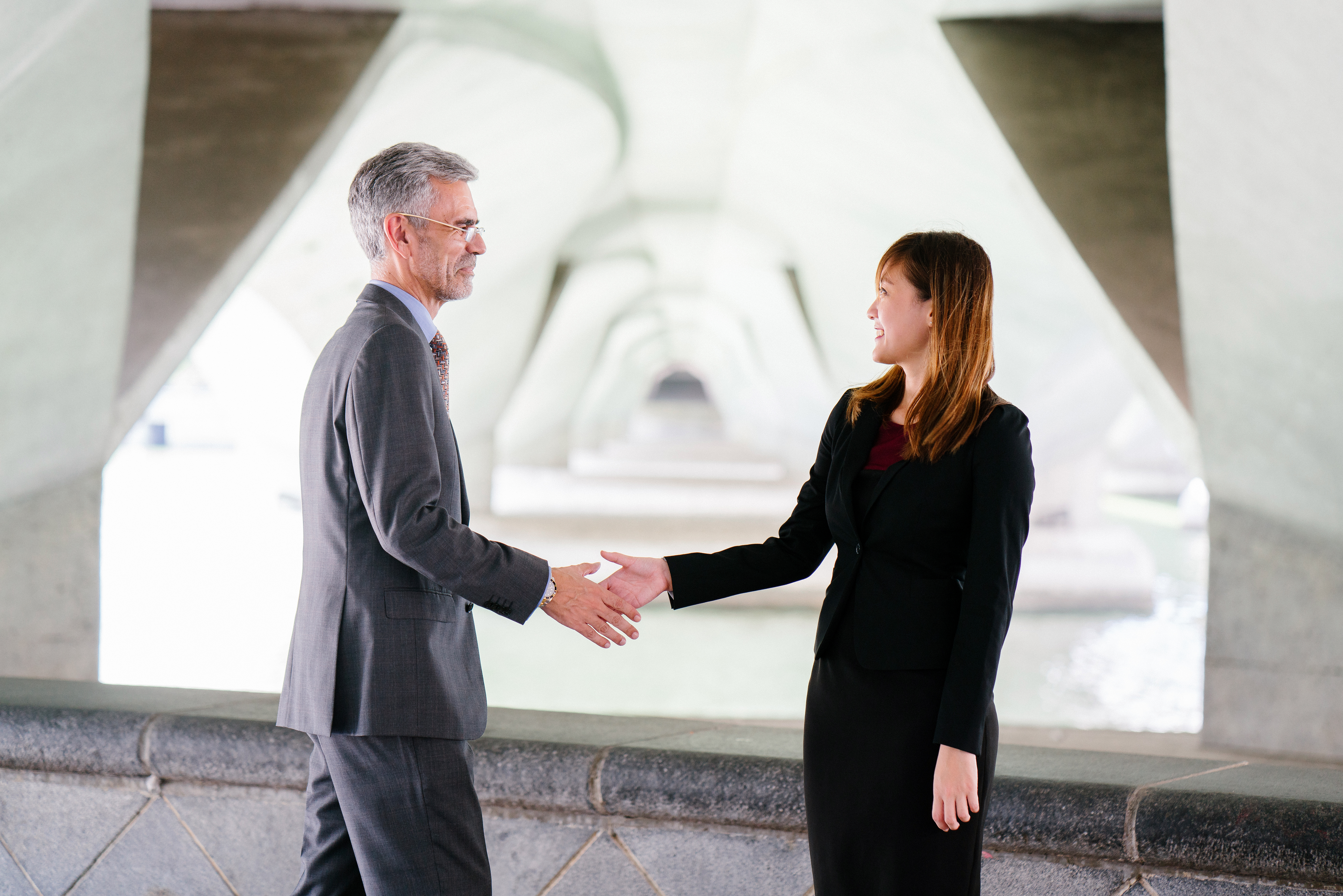 Canva - Man and Woman Shaking Hand in Focus Photography