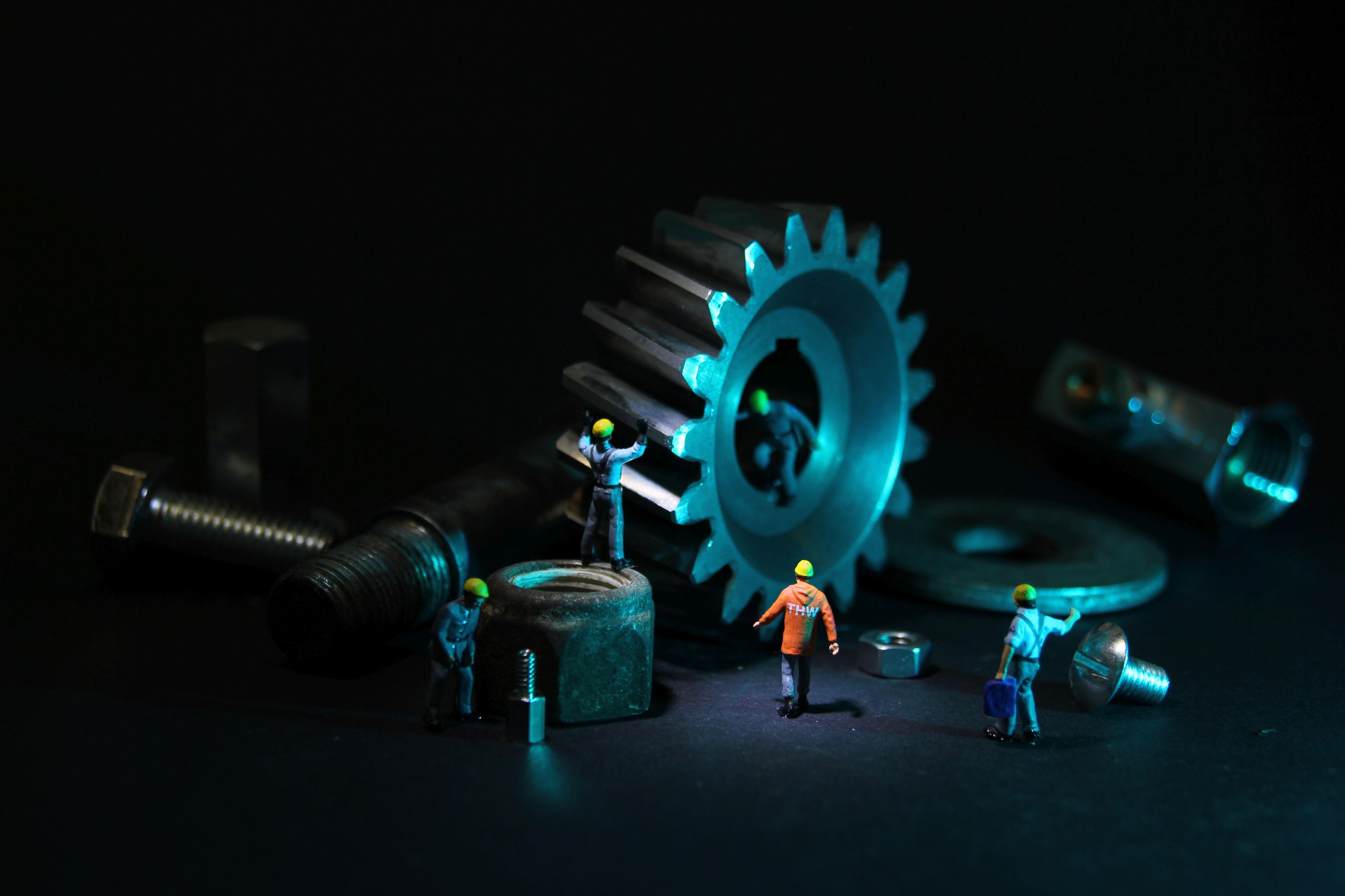 Canva - Tiny Mechanic Figures Next To Tools