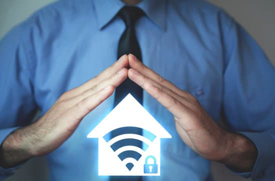 Man with home wifi security icon.